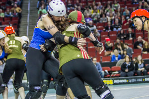 Domino Scarvy lays a sternum hit on Devilynne Syde. Photo by Don Jensen