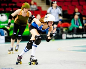 Far from her Pathfinder roots with the Seattle Derby Brats, Izzy Does It lives her dream jamming for the Sockit Wenches. Photo by Frank Blau
