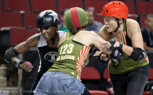 DLF's Full Nelson and Yoko Onoudi'nt work together to try and stop Throttle Rockets' jammer Luna Negra. Photo by Jenny Evans.