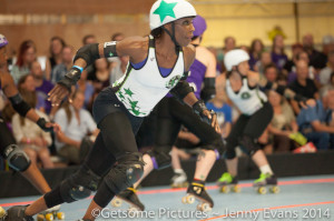 Rat City's leading scorer of the night, Luna Negra, breaks through the pack.  Photo by Jenny Evans
