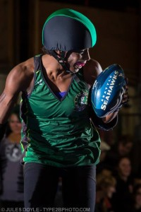Luna Negra brings a football to the track (photo by Jules Doyle)