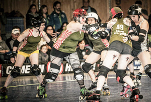 DLF Coach Ho Chi Danh said that his blockers played as a unit. This unit of Dirty South, Wicked Slam, Kamikaze Kim and Raven Evergore are putting the stop to Throttle Rockets jammer Ethel Vermin. Photo by Jenny Evans.
