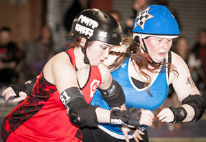 Who's fastest to the opening gets the points. In this case Sister Slaughter was not stopped by Grave Danger blocker Ponyo Knees, picking up some of her 54 points for the bout. Photo by Jenny Evans.