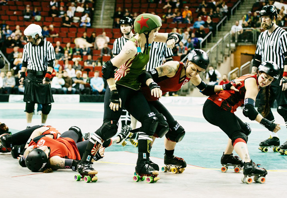 Jill Nye the Science Guy explained the science of gravity to two   Grave Danger blockers as she completes the scoring pass against a   couple more Grave Danger skaters, Rodger That and Ponyo Knees. Photo by   Danny Ngan.