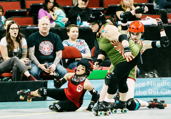The fans are right, it can hurt sometimes. Grave Danger jammer   Nehi Nightmare started the bout with a sore back, not helped much by   the lack of mercy shown by DLF blockers Wicked Slam and Punk 'N Pie.   Photo by Danny Ngan.