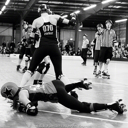 You can sometimes score points by getting past Throttle Rockets blocker Parker Eye Out (070) but it's not the recommended way to spend a quiet evening as Grave Danger jammer J Killa learned here. Photo by Bob Ayers.